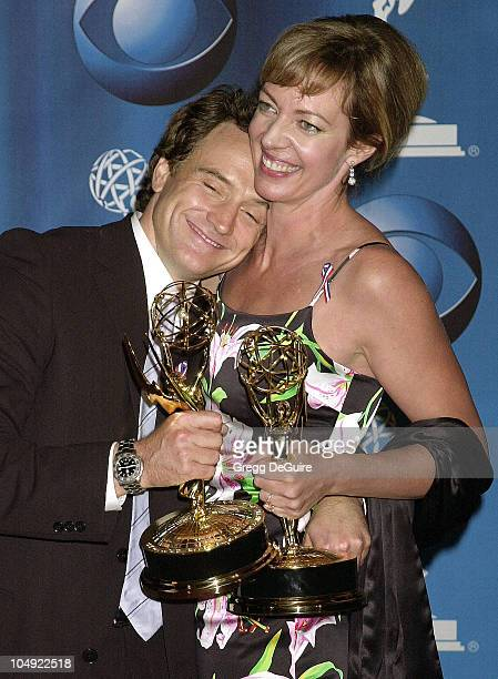 Bradley Whitford & Allison Janney, wearing diamond drop earrings from Neil Lane, show their Emmys for Best Supporting Actor and Actress In A Drama...