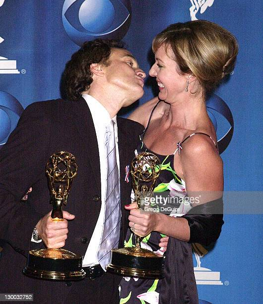 Bradley Whitford Allison Janney wearing diamond drop earrings from Neil Lane show their Emmys for Best Supporting Actor and Actress In A Drama Series...