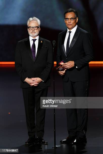 Bradley Whitford and Jimmy Smits speak onstage during the 71st Emmy Awards at Microsoft Theater on September 22 2019 in Los Angeles California