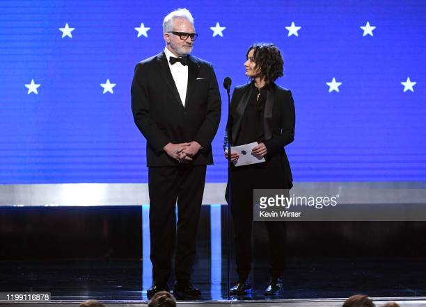 Bradley Whitford and Sara Gilbert speak onstage during the 25th Annual Critics' Choice Awards at Barker Hangar on January 12 2020 in Santa Monica...