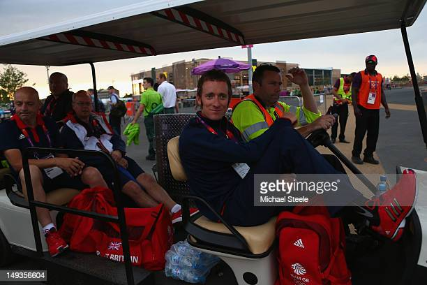 Bradley Wiggins and Dave Brailsford are driven by buggy across the Olympic Park to attend the London 2012 Olympic Games Opening Ceremony at the...