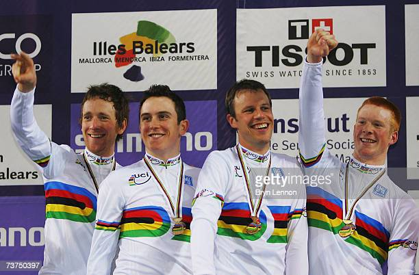 Bradley Wiggins Geraint Thomas Paul Manning and Ed Clancy of Great Britain celebrate victory in the Team Pursuit race at the UCI Track Cycling World...