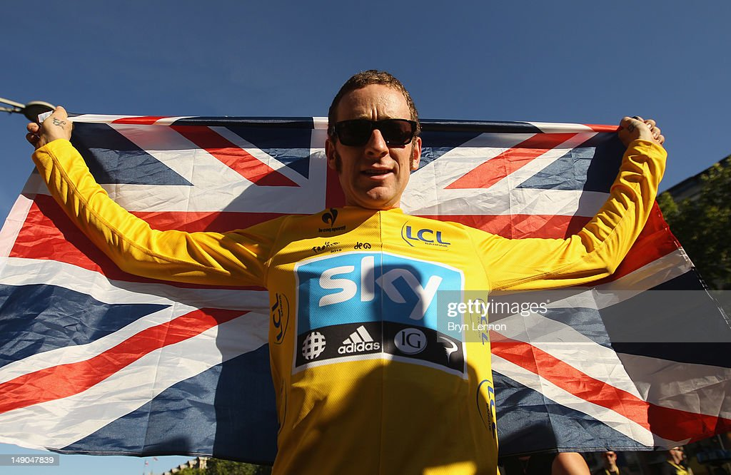 Bradley Wiggins of Great Britain and SKY Procycling celebrates on a processional lap after winning the 2012 Tour de France after the twentieth and final stage of the 2012 Tour de France, from Rambouillet to the Champs-Elysees on July 22, 2012 in Paris, France.