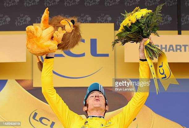 Bradley Wiggins of Great Britain and SKY Procycling celebrates on the podium after securing the yellow jersey of the general classification during...