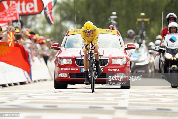 Bradley Wiggins of Great Britain and SKY Procycling crosses the line to winn the stage and secure the yellow jersey of the general classification...