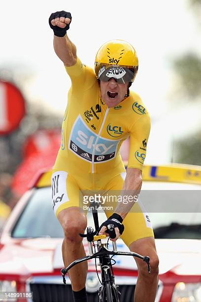 Bradley Wiggins of Great Britain and SKY Procycling punches the air with delight as he celebrates winning the stage and securing the yellow jersey of...