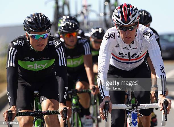 Bradley Wiggins of Great Britain and SKY Procycling rides with team mate Edvald Boasson Hagen of Norway during a training ride on July 1 2011 in Les...