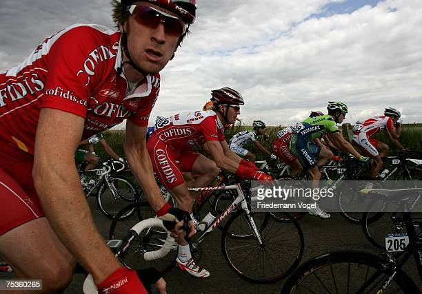 Bradley Wiggins of Great Britain and the Cofidis Team rides in the pack during the Stage Four of the Tour de France between Villers-Cotterets and...