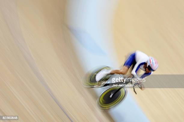 Bradley Wiggins of Great Britain breaks an olympic record with a time of 4:15.031 while qualifying for the men's indivdual pursuit during the track...