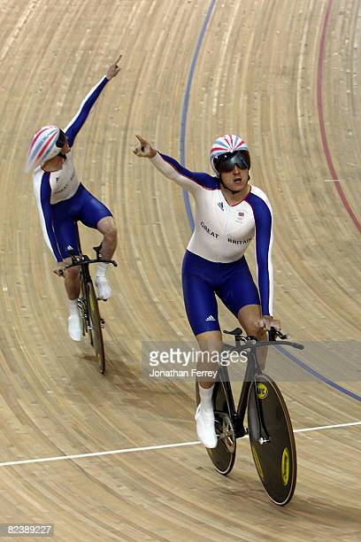 Bradley Wiggins of Great Britain celebrates after he and his team broke the world record of 3:55.205 in the men's team pursuit track cycling event...