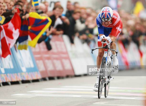 Bradley Wiggins of Great Britain crosses the finishline to take the silver medal in the Elite Men's Time Trial on day three of the UCI Road World...
