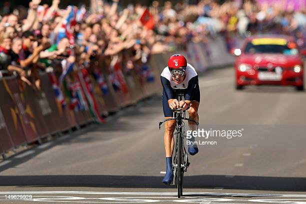 Bradley Wiggins of Great Britain crosses the line to win the Men's Individual Time Trial Road Cycling on day 5 of the London 2012 Olympic Games on...