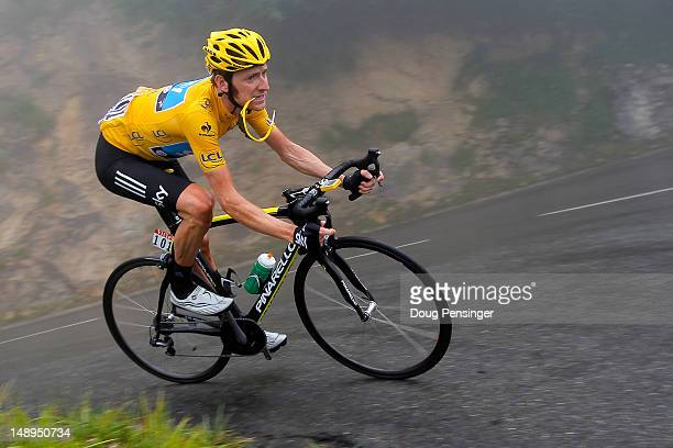 Bradley Wiggins of Great Britain riding for Sky Procycling descends the Col de Mente as he defended the race leader's yellow jersey during stage...