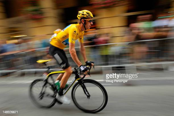 Bradley Wiggins of Great Britain riding for Sky Procycling in the race leader's yellow jersey makes his way to the start of stage twelve of the 2012...