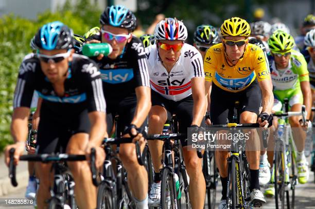 Bradley Wiggins of Great Britain riding for Sky Procycling is escorted by his teammates Bernhard Eisel Christian Knees and Edvald Boasson Hagen as he...