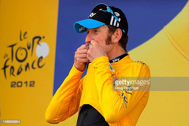 Bradley Wiggins of Great Britain riding for Sky Procycling kisses the race leader's yellow jersey after defending it with a win in the individual...