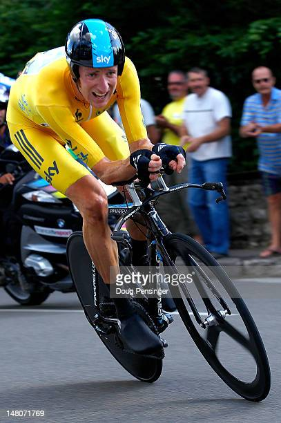Bradley Wiggins of Great Britain riding for Sky Procycling rides to first place in the individual time trial and defended the race leader's yellow...