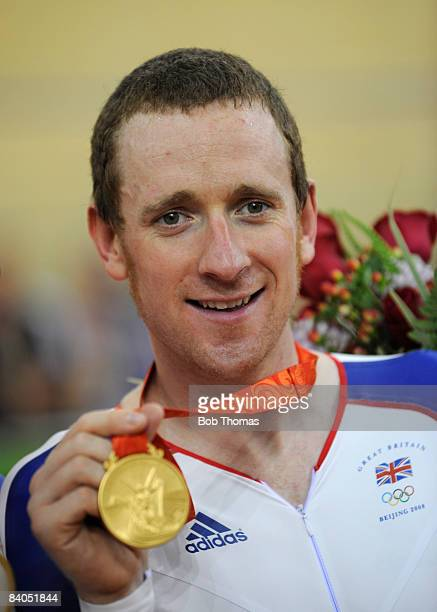 Bradley Wiggins of Great Britain team holds his gold medal after winning the Men's Team Pursuit Finals at the Laoshan Velodrome on Day 10 of the...