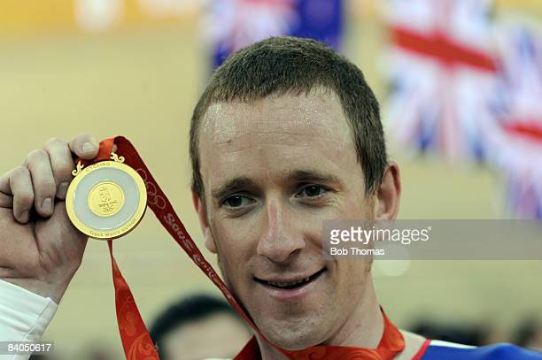 Bradley Wiggins of Great Britain with his gold medal after winning the Men's Individual Pursuit Final held at the Laoshan Velodrome on Day 8 of the...