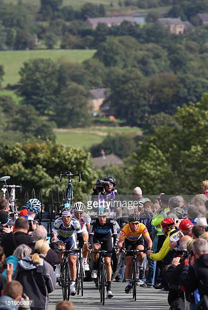 Bradley Wiggins of Sky Pro Cycling is followed by Leigh Howard of Orica - GreenEDGE and Mark Cavendish of Sky Pro Cycling as they climb Gun Hill in...