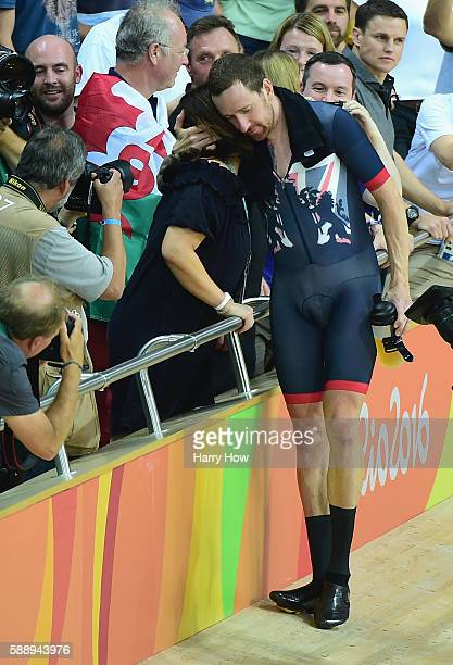 Bradley Wiggins of Team Great Britain kisses his wife Catherine to celebrate winning the gold medal after the Men's Team Pursuit Final for Gold on...