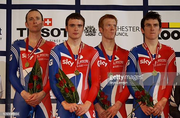 Bradley Wiggins Steven Burke Edward Clancy and Geraint Thomas of Great Britain stand with the gold medals following their victory in the Men's Team...