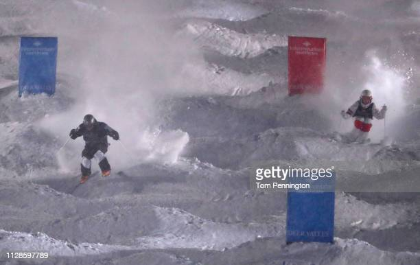 Bradley Wilson of the United States competes against Mikael Kingsbury of Canada in the Big Final of the Men's Dual Moguls Final of the FIS Freestyle...