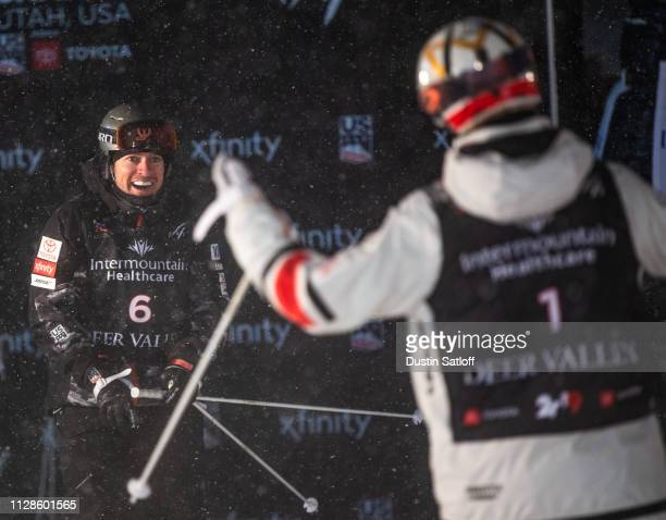Bradley Wilson of the United States looks at Mikael Kingsbury of Canada after the final in the Men's Dual Moguls Final of the FIS Freestyle Ski World...