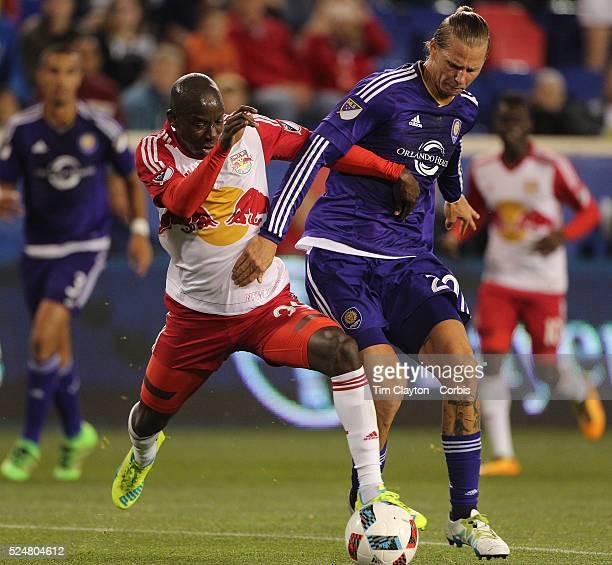 Bradley WrightPhillips #99 of New York Red Bulls is challenged by Brek Shea of Orlando City FC during the New York Red Bulls Vs Orlando City MLS...