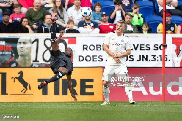 Bradley WrightPhillips of New York Red Bulls attempts an overhead kick watched by Bastian Schweinsteiger of Chicago Fire in action during the New...
