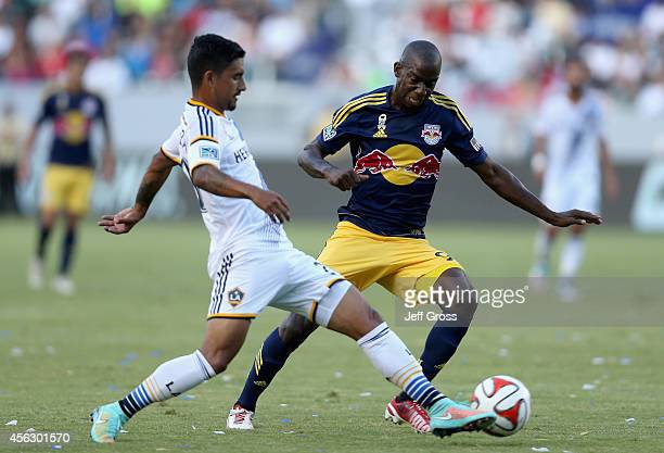 Bradley WrightPhillips of New York Red Bulls is challenged for the ball by AJ DeLaGarza of Los Angeles Galaxy in the first half at StubHub Center on...