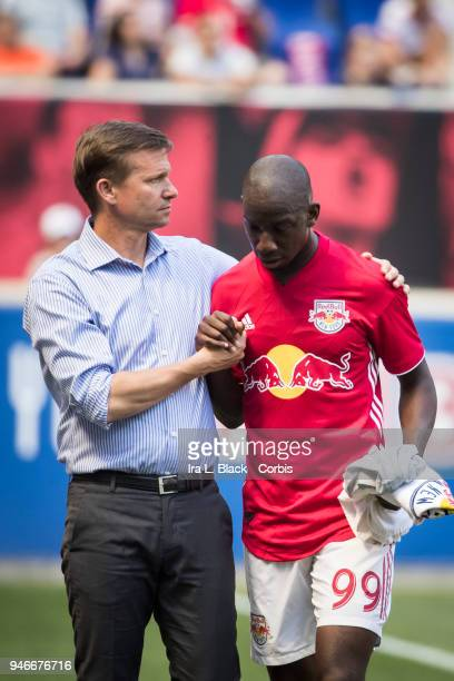 Bradley WrightPhillips of New York Red Bulls is given a handshake from Jesse Marsch Head Coach as Phillips is substituted out during the Major League...