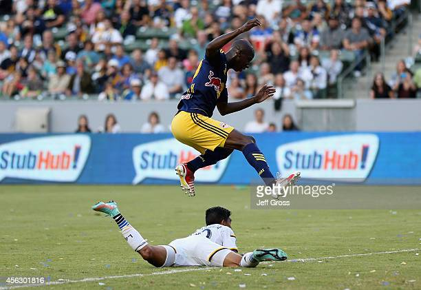 Bradley WrightPhillips of New York Red Bulls jumps over AJ DeLaGarza of Los Angeles Galaxy in the first half at StubHub Center on September 28 2014...