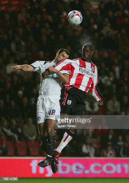Bradley WrightPhillips of Southampton battles in the air with Chris Barker of Colchester during the CocaCola Championship match between Southampton...