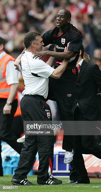 Bradley WrightPhillips of Southampton jumps on his manager Nigel Pearson as they celebrate avoiding relegation during the CocaCola Championship match...