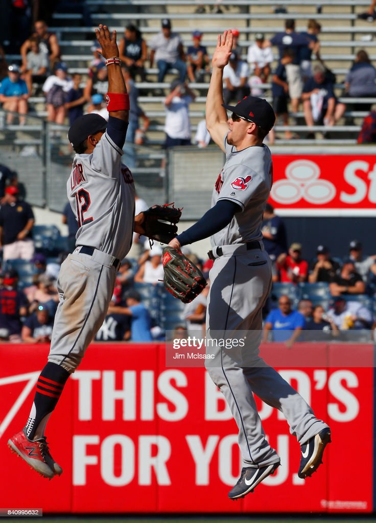 Bradley Zimmer #4 and Francisco Lindor #12 of the Cleveland Indians celebrate after defeating the New York Yankees in the first game of a doubleheader at Yankee Stadium on August 30, 2017 in the Bronx borough of New York City.