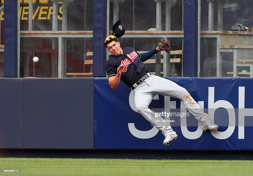 Bradley Zimmer #4 of the Cleveland Indians can't come up with a ball hit by Austin Romine of the New York Yankees for a double in the seventh inning at Yankee Stadium on May 5, 2018 in the Bronx borough of New York City.