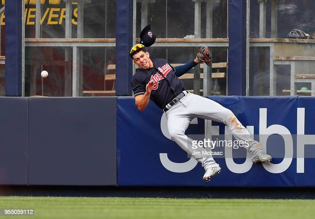 Bradley Zimmer of the Cleveland Indians can't come up with a ball hit by Austin Romine of the New York Yankees for a double in the seventh inning at...