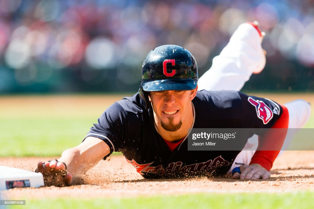 Bradley Zimmer #4 of the Cleveland Indians dives back to first base on a pickoff attempt during the sixth inning against the Baltimore Orioles at Progressive Field on September 9, 2017 in Cleveland, Ohio.