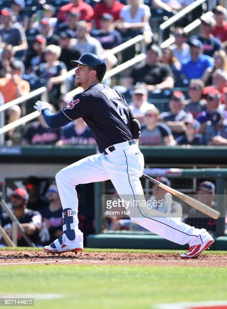 Bradley Zimmer of the Cleveland Indians follows through on a swing during a spring training game against the Texas Rangers at Goodyear Ballpark on...