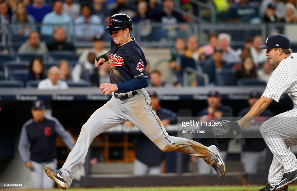 Bradley Zimmer #4 of the Cleveland Indians scores a run in the seventh inning after a wild pitch from Adam Warren #43 of the New York Yankees at Yankee Stadium on August 28, 2017 in the Bronx borough of New York City.