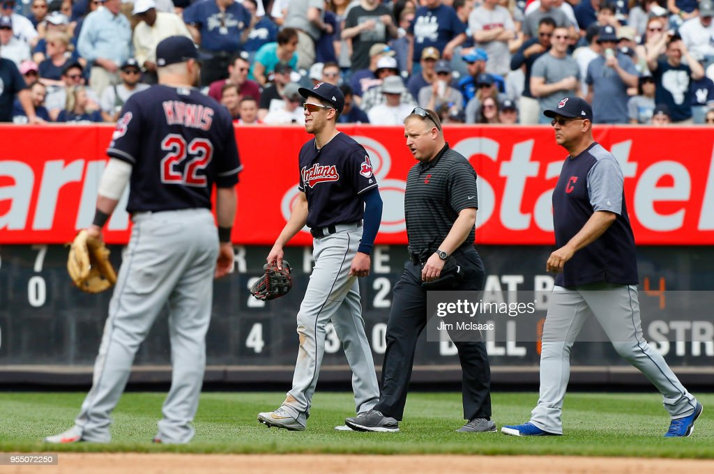 Bradley Zimmer #4 of the Cleveland Indians walks off the field past teammate Jason Kipnis #22 after an injury in the seventh inning against the New York Yankees with a trainer and manager Terry Francona at Yankee Stadium on May 5, 2018 in the Bronx borough of New York City.