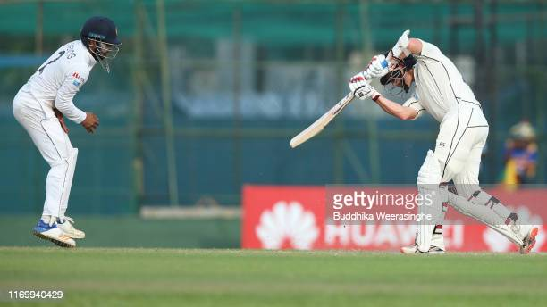 BradleyJohn Watling of New Zealand as Kusal Mendis of Sri Lanka leaps into air to avoid being hit by the ball during the day three of Second Test...