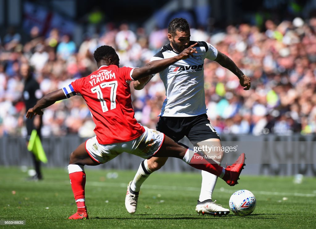 BradleyJohnson of Derby County is tackled by Andy Yiadom of Barnsley during the Sky Bet Championship match between Derby County and Barnsley at iPro Stadium on May 6, 2018 in Derby, England.