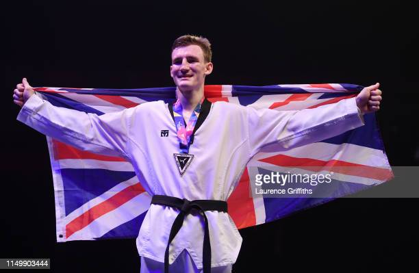 Bradly Sinden of Great Britain celebrates with his Gold medal after victory against Javier Perez Polo of Spain in the Final of the Mens -68kg during...