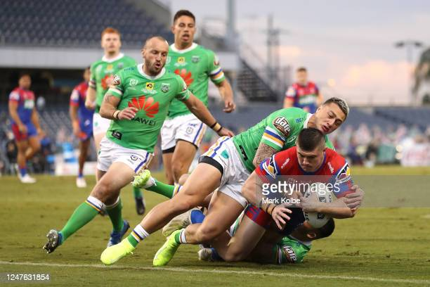 Bradman Best of the Knights scores a try during the round four NRL match between the Canberra Raiders and the Newcastle Knights at Campbelltown...