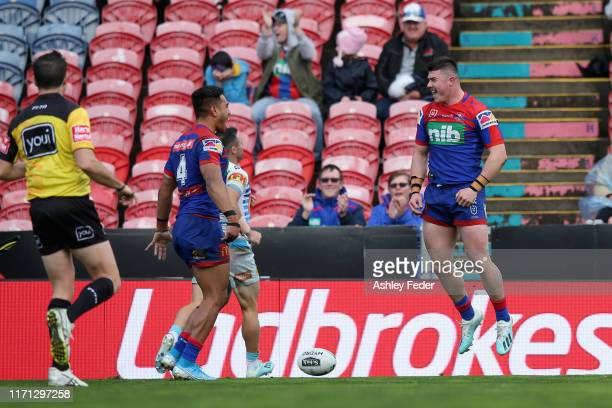 Bradman Best of the Newcastle Knights celebrates his try with Hymel Hunt during the round 24 NRL match between the Newcastle Knights and the Gold...