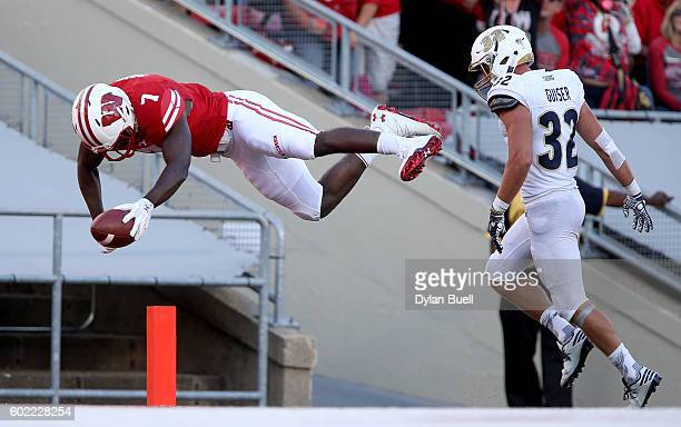 Bradrick Shaw of the Wisconsin Badgers dives into the endzone to score a touchdown past Zach Guiser of the Akron Zips in the fourth quarter at Camp...