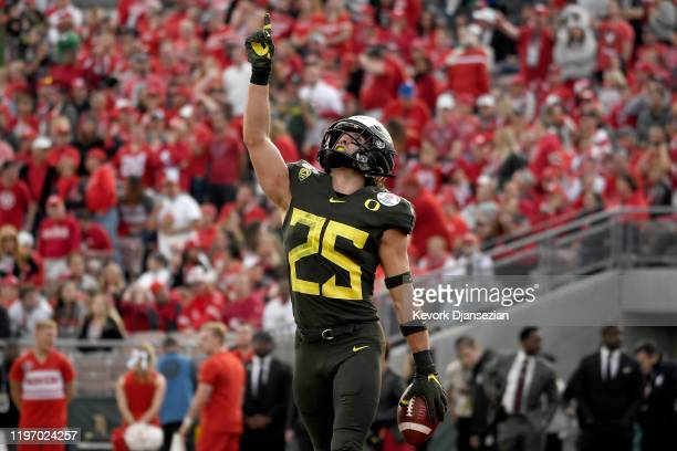 Brady Breeze of the Oregon Ducks celebrates after scoring a 31 yard touchdown off of a recovered fumble on a punt by the Wisconsin Badgers during the...