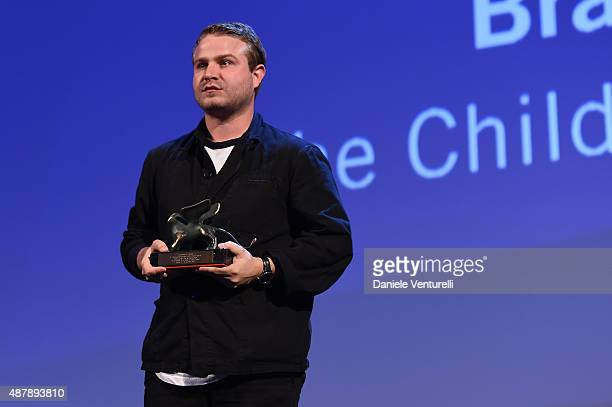 Brady Corbet with the Orizzonti Award for Best Director for 'The Childhood of a Leader' on stage at the closing ceremony during the 72nd Venice Film...